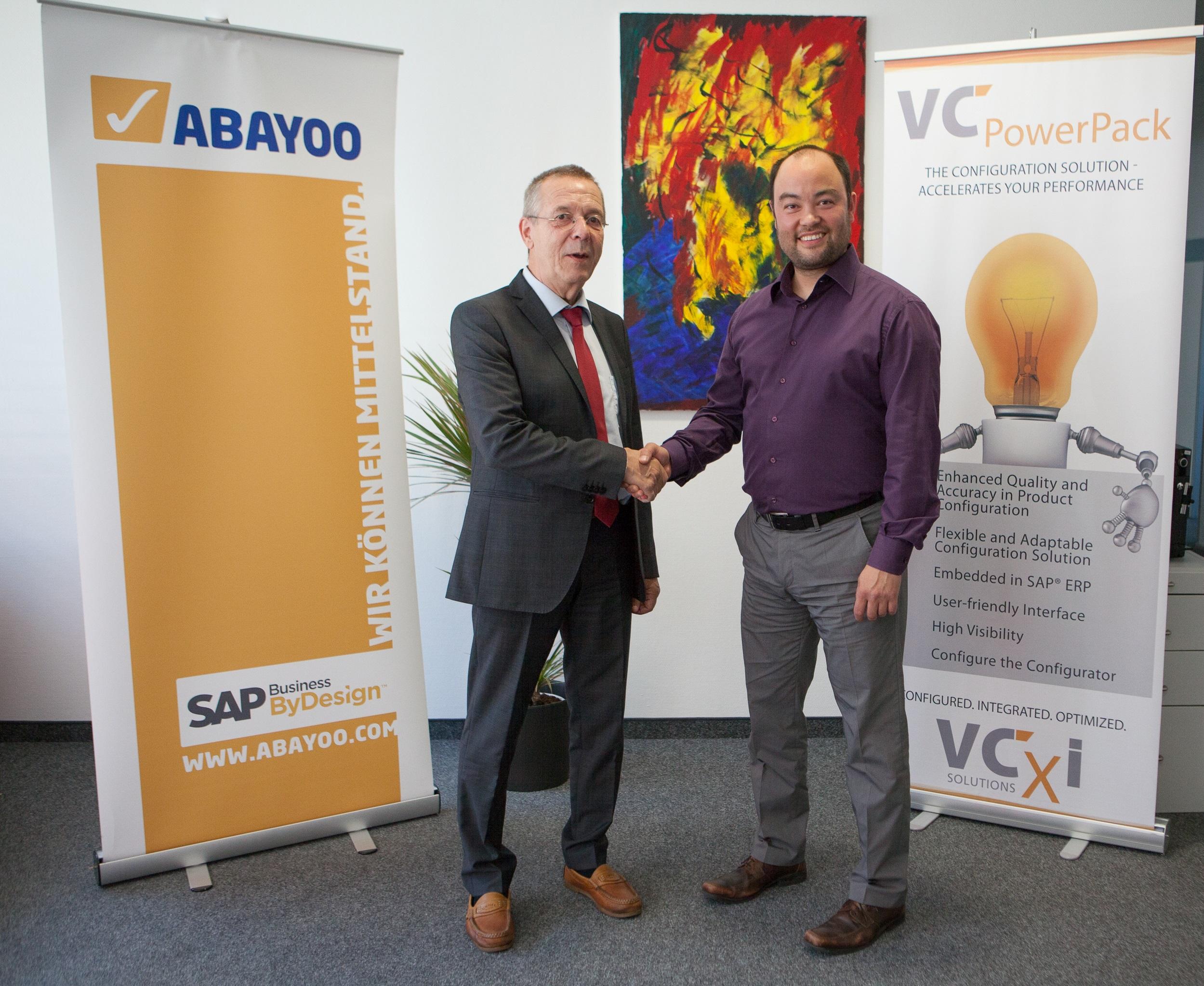 AICOMP Gruppe �bernimmt ABAYOO: Wolfgang Schmidt, Gesch�ftsf�hrer der ABAYOO (links) und Markus Blunk, Global Director Cloud der AICOMP Gruppe